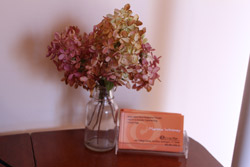 Martha Whitney's business card and flowers